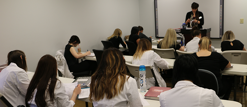 Cosmetology, Barber and Esthetics Instructor leads a class at Paroba.