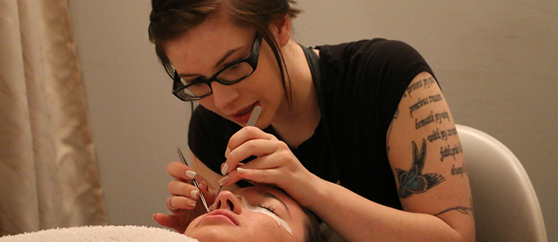 Esthetics student learning the skin care, make-up & advanced beauty services offered in high-end salons