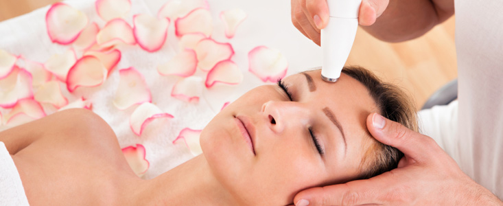 Master Esthetics student learning hands-on in a real laser spa environment