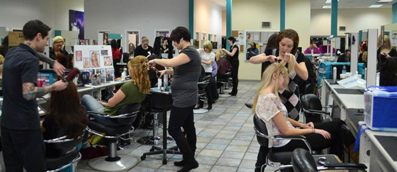Students in the salon learning to take care of their customers.